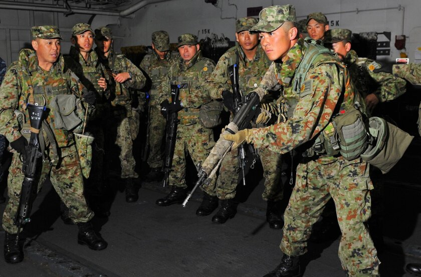 Soldiers from the Japan Ground Self-Defense Force conduct small-arms weapons training aboard the amphibious assault ship Peleliu during Iron Fist 2012. U.S. Navy/Photo by Petty Officer 2nd Class Michael Russell