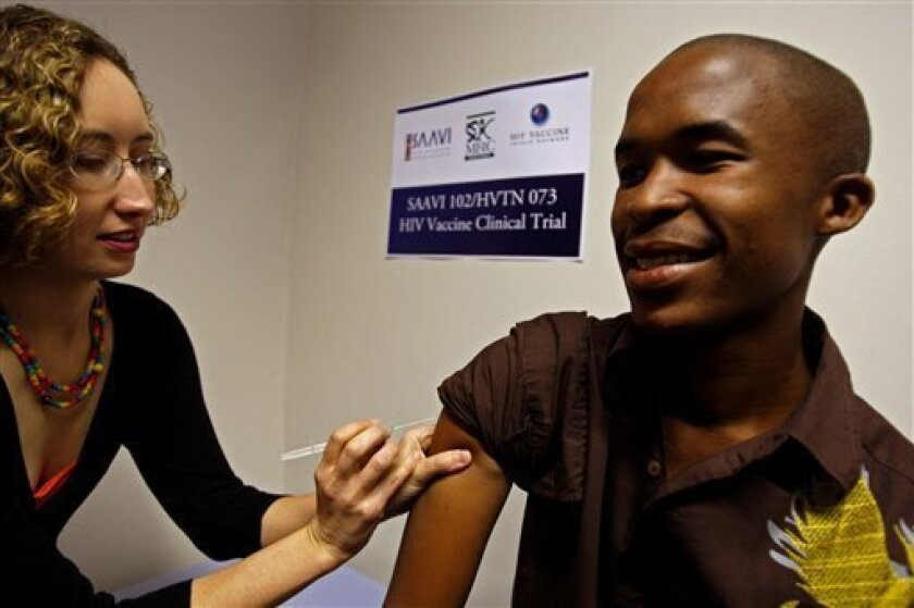 Dr Danielle Crida, left,  demonstrates how a new Aids vaccine is administrated on a trail subject, Wanda Mbele, right, at the Emavundleni Centre situated in the Crossroads township on the outskirts of  Cape Town, South Africa, Monday, July 20, 2009.The leading scientist of the first AIDS vaccine cr