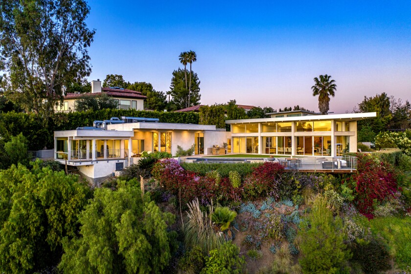 A hospital-grade HEPA and UV air purification system is among health-conscious features found at this Beverly Hills contemporary, listed for sale at $9.995 million. The 5,300-square-foot house features 42 custom Fleetwood windows and doors. Its two-room pantry suite is stocked with a six-month supply of food. The home has whole-house audio, video and lighting systems that can be controlled with the push of a button. In the garage, there are two quick-chargers for electric vehicles.