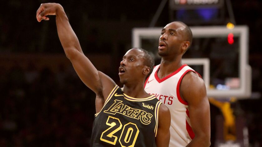 LOS ANGELES, CALIF. - APR. 10, 2018. Lakers guard Andre ingram follows through on a three-point sho