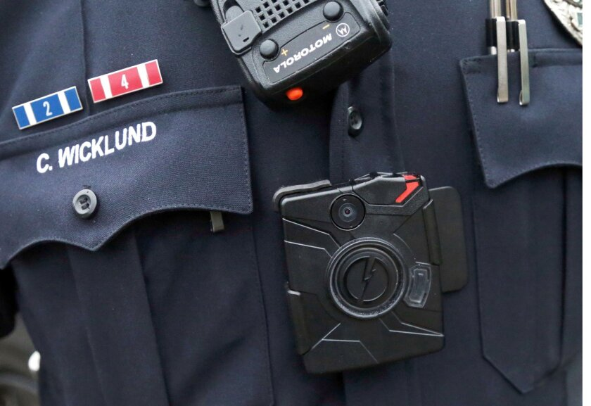 FILE  - In this Nov. 5, 2014 file photo, Sgt. Chris Wicklund of the Burnsville, Minn., Police Department wears a body camera beneath his microphone. Cleveland's move to buy 1,500 police body cameras and data storage could cost up to $3.3 million over five years, a higher price tag than previously k