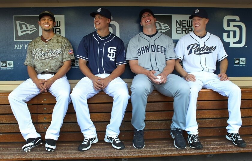 Left to right, Jason Bartlett, Will Venable, Clayton Richard and Nick Hundley share a laugh as they modeled Padres' new uniforms.