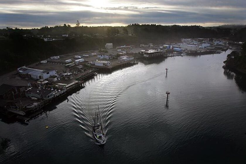 A fishing boat leaves Noyo Harbor in Fort Bragg, Calif., which has considered a name change.
