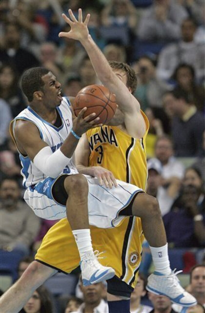 New Orleans Hornets guard Chris Paul (3) is blocked by Indiana Pacers forward Troy Murphy (3) in the second half of their NBA basketball game in New Orleans, Monday, Jan. 19, 2009.  (AP Photo/Bill Haber)