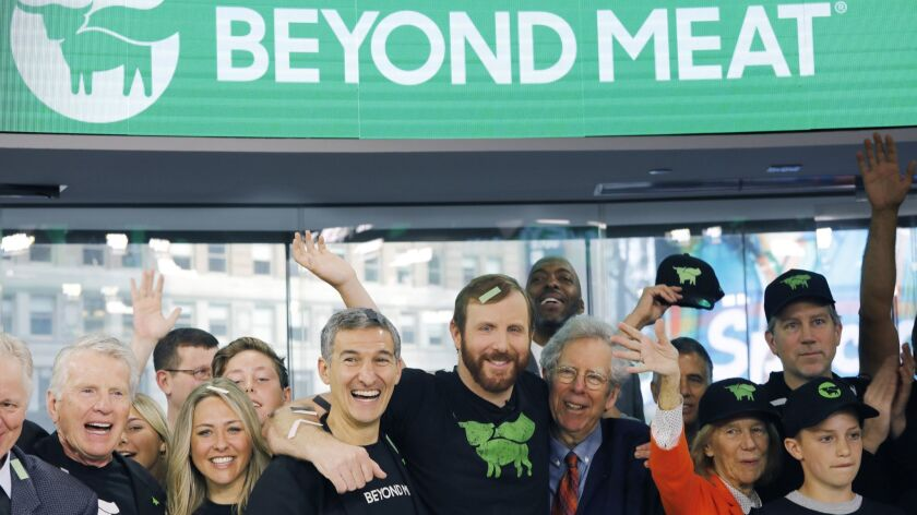 FILE - In this May 2, 2019, file photo Ethan Brown, center, CEO of Beyond Meat, attends the Opening
