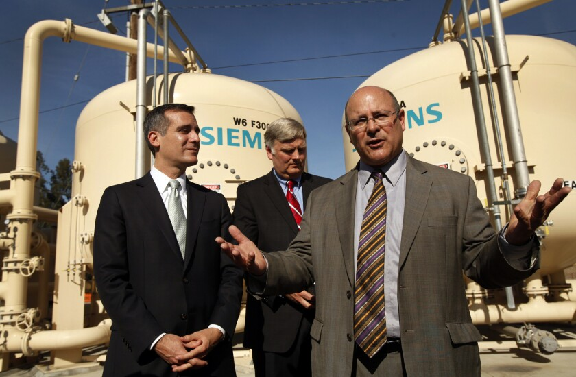 Mayor Eric Garcetti, left, and Marty Adams of the DWP, right, at water facility in Arleta