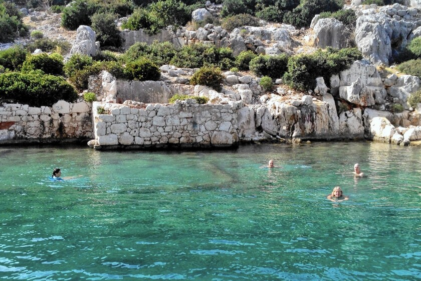A small group from the Azamara Quest chartered a smaller boat in Kas, Turkey, to take them to Kekova Island, where they swam amid the ruins of a partially sunken ancient city.