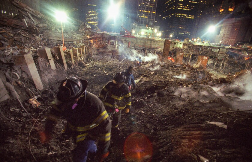 Fall 2001: Members of New York Fire Department Rescue Company 5 search the World Trade Center site looking for victims of the Sept. 11 terror attacks. They lost 11 members of the company and spent nine months looking for their comrades and other victims.