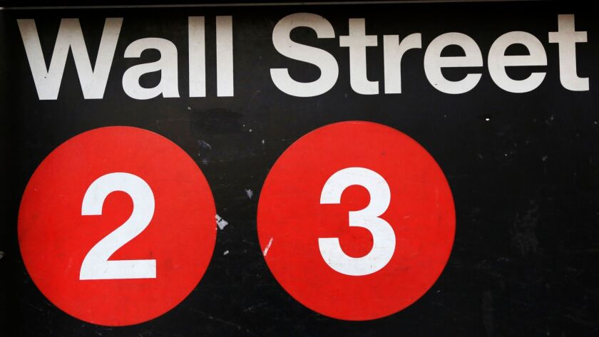 FILE - This Friday, Jan. 15, 2016, file photo shows a sign for a Wall Street subway station in New Y