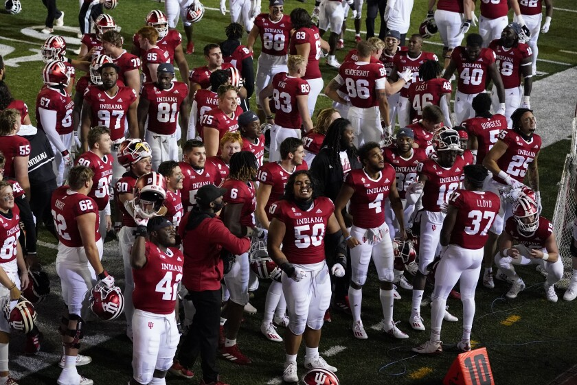 Indiana players celebrate after defeating Penn State in overtime of an NCAA college football game, Saturday, Oct. 24, 2020, in Bloomington, Ind. Indiana won 36-35 in overtime. (AP Photo/Darron Cummings)