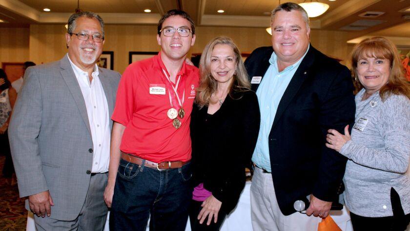 Liza Boubari, HealWithin International President, won the nonprofit raffle (middle). She is joined