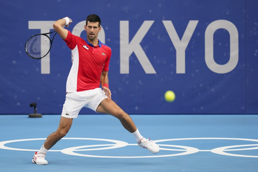 Novak Djokovic, of Serbia, returns to Jan-Lennard Struff, of Germany, during second round of the tennis competition at the 2020 Summer Olympics, Monday, July 26, 2021, in Tokyo, Japan. (AP Photo/Patrick Semansky)