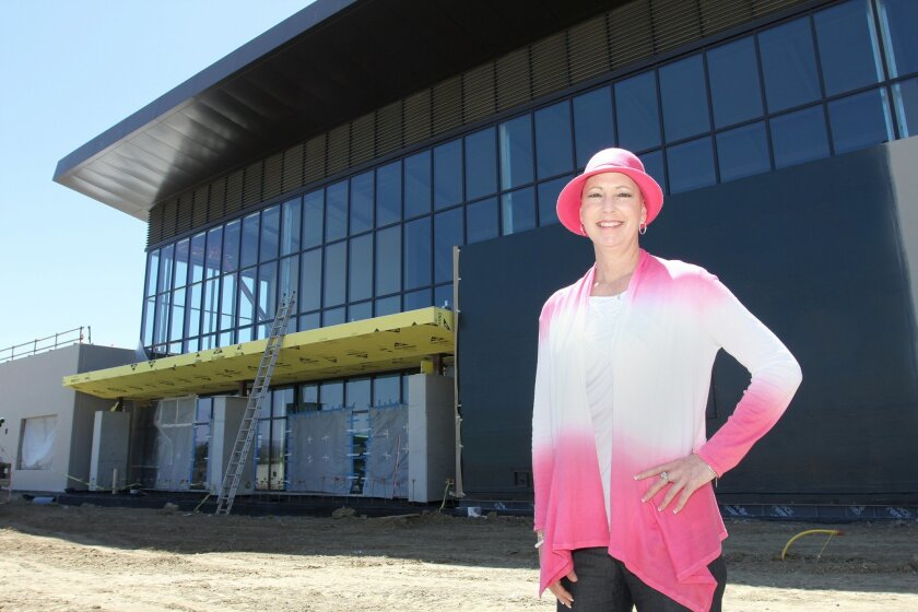 San Marcos High Principal Julie Mottershaw runs the school amid a massive reconstruction, which includes the new gym behind her, and treatment for cancer.