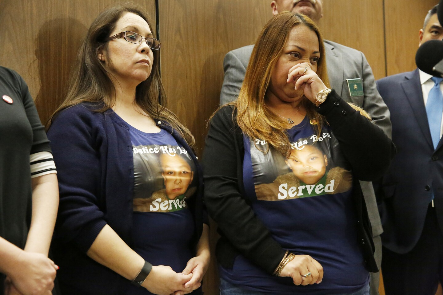 """Gabriel Fernandez's cousin Emily Carranza, left, and Olivia Rubio wear shirts printed with """"Justice Has Been Served"""" as they talk to media after Gabriel's mother and her boyfriend were sentenced for the boy's killing."""