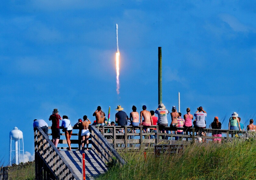 Crowds pack the Canaveral National Seashore on May 27 to witness the liftoff of a SpaceX Falcon 9 rocket with the THAICOM-8 satellite aboard.