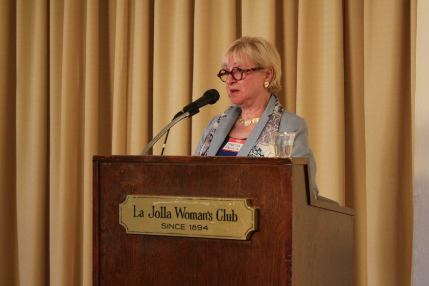 Matha Dennis addresses the La Jolla Woman's Club.