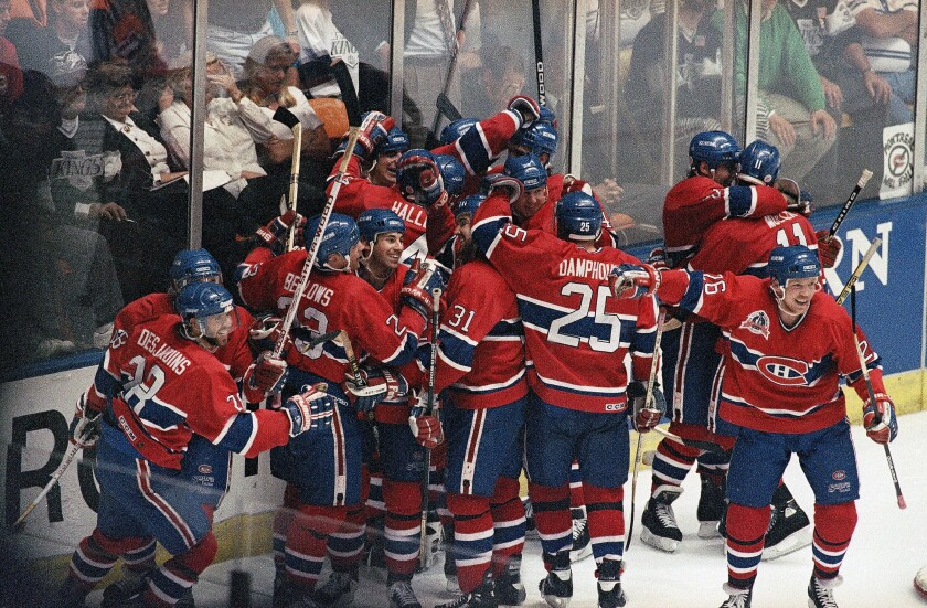 The Montreal Canadiens celebrate their overtime victory over the Kings in Game 4 of the 1993 Stanley Cup Final.