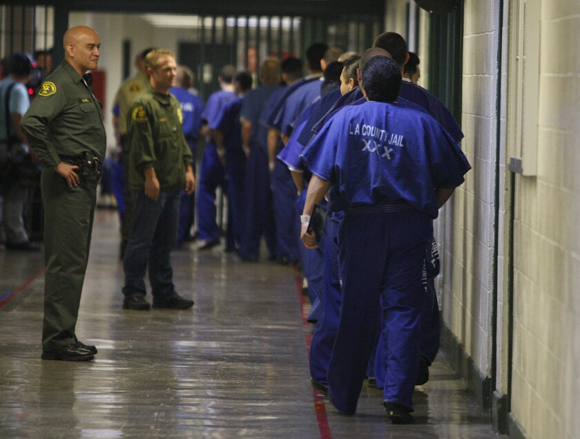 Inmates are watched by members of the Los Angeles County Sheriff's Department at the Men's Central Jail in 2012.