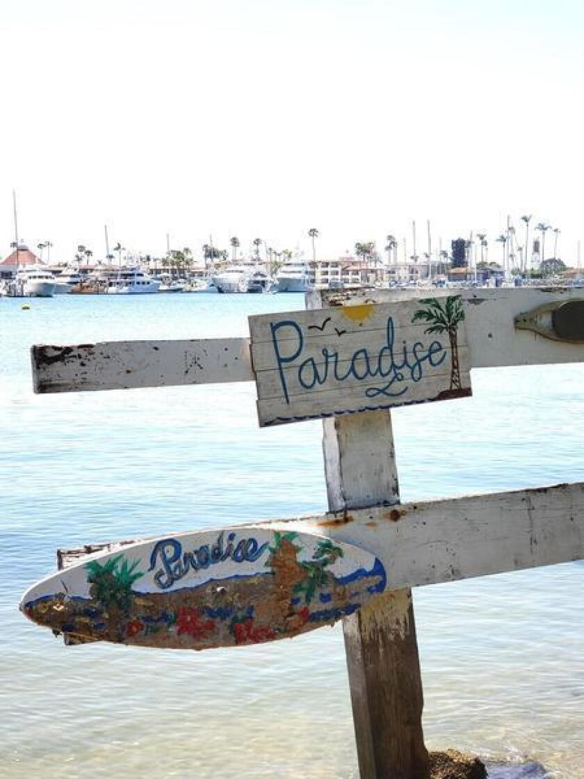 IN YOU EVER GET LOST ... Signs mark your way to Paradise (in someone's eyes!) along La Playa Bayside Trail at Kellogg Beach.