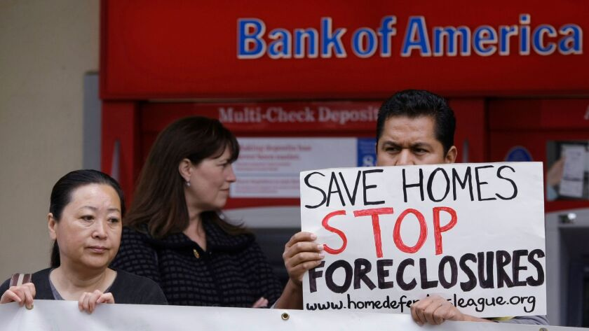 Activists rally in front of a Bank of America in San Jose in 2011 to protest mortgage foreclosures.