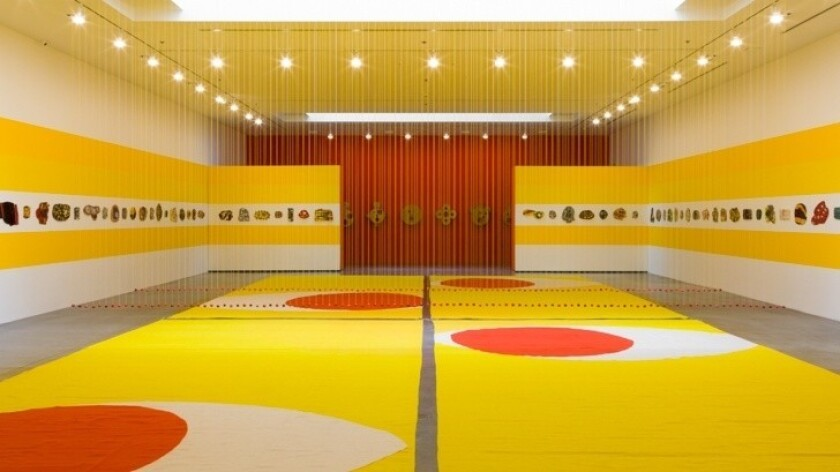 Polly Apfelbaum's installation assembles rugs, beads, clay tablets and wood icons to create a kind of secular chapel.
