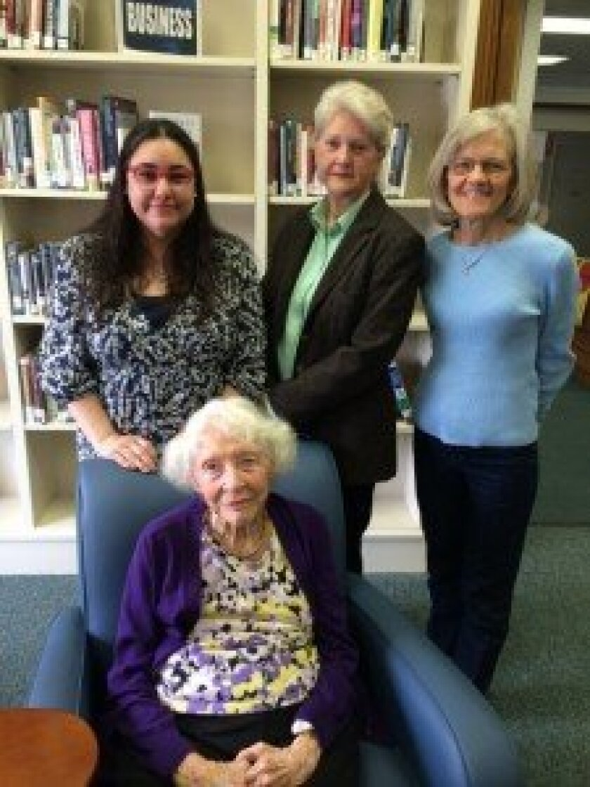 The Rancho Santa Fe Library's first librarian Fran Johnson with current library staff Caryl Andrews, Jan Stevens and Josephine Moeller. Photo/Karen Billing