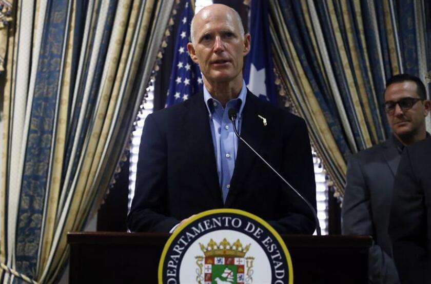 El gobernador de Florida, Rick Scott, habla durante una conferencia de prensa celebrada en el Departamento de Estado en San Juan (Puerto Rico). EFE/Archivo