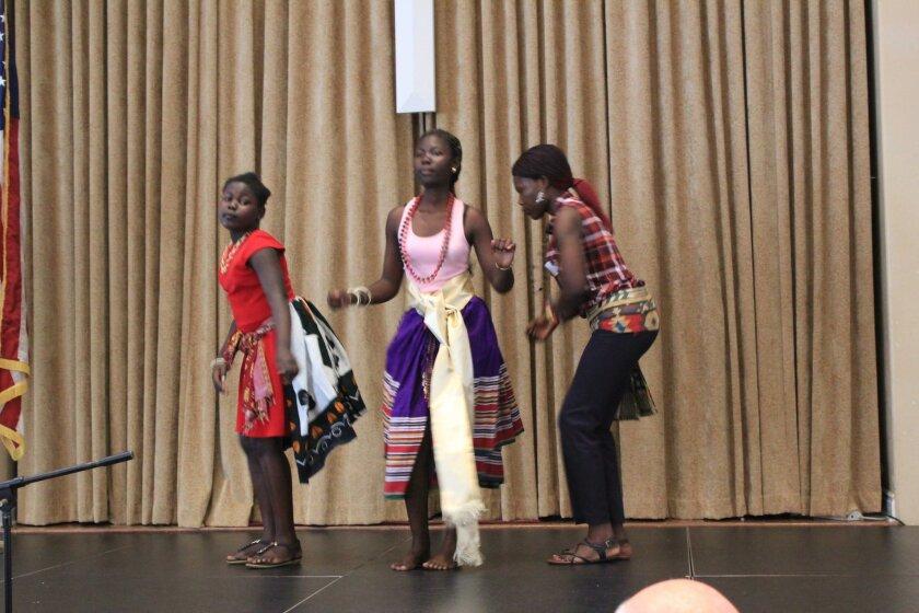 Annet Keji, Mary Jua and Hellen Oleyo perform the traditional Acholi dance from Uganda.
