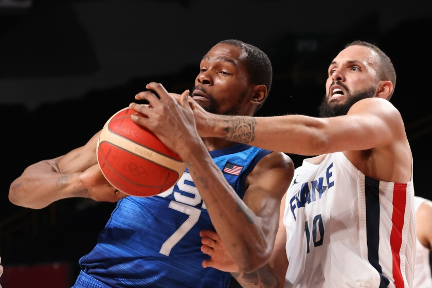 Evan Fournier and Kevin Durant vie for the ball.