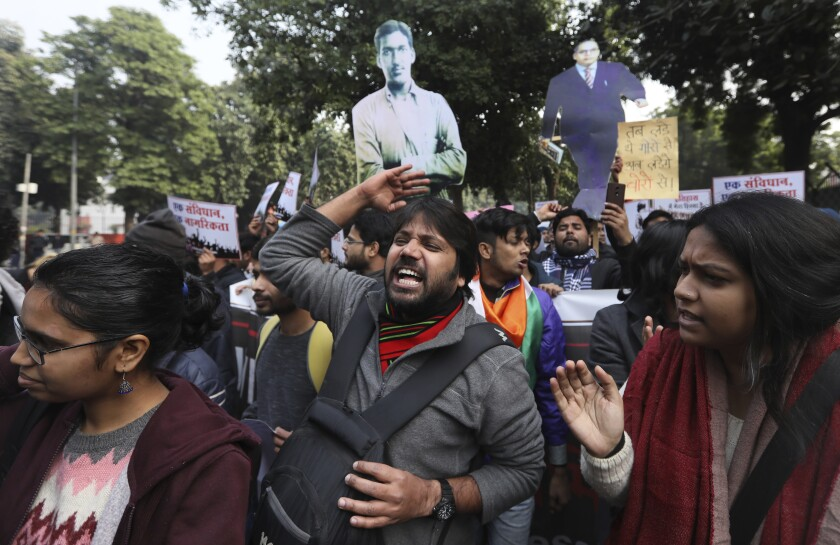 Students in New Delhi shout antigovernment slogans during a protest Tuesday against a new citizenship law.