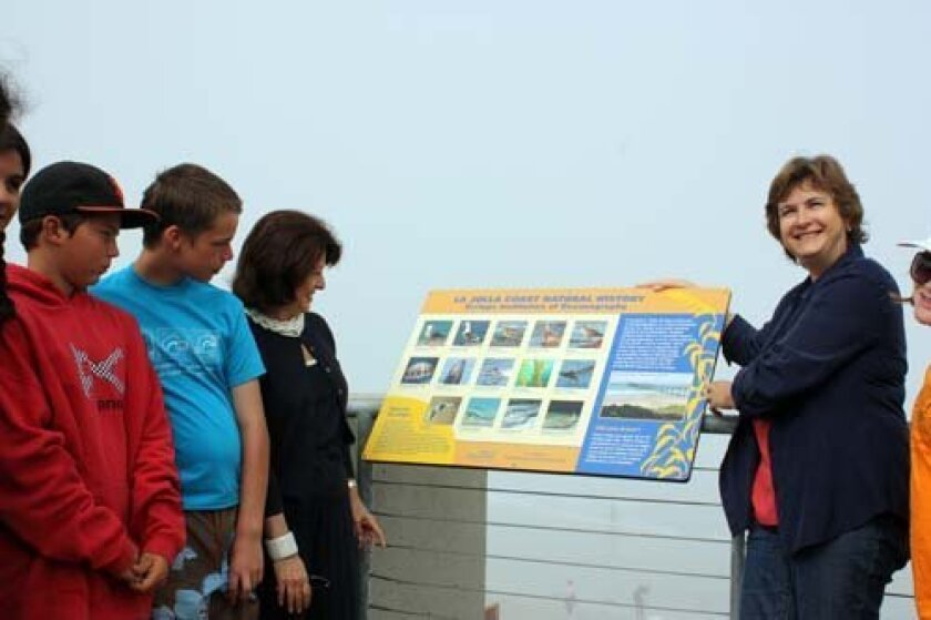 Students from the Birch Aquarium Summer Learning Camp check out the interpretive panel after it was installed Wednesday as Phyllis Pfeiffer, president of the La Jolla Community Foundation, and Nigella Hillgarth, executive director of the Birch Aquarium, stand by. Photo: Kathy Day