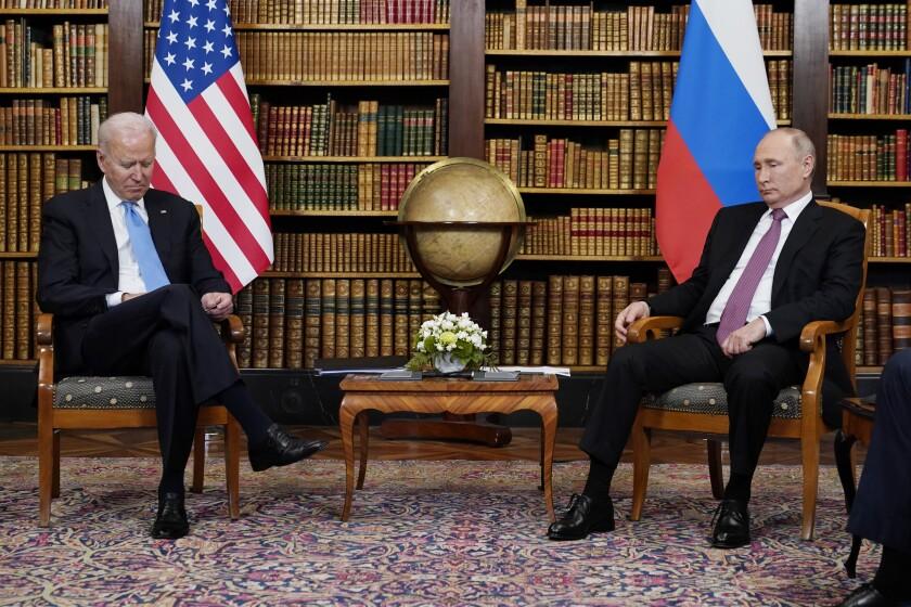 President Biden and Russian President Vladimir Putin sit before their meeting.