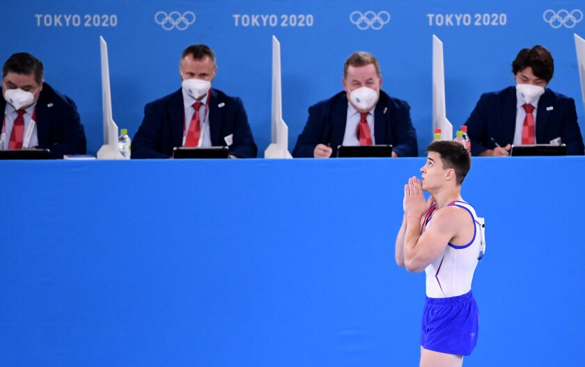 Russia Olympic Committee's Nikita Nagornyy gestures as he walks past the judges table.