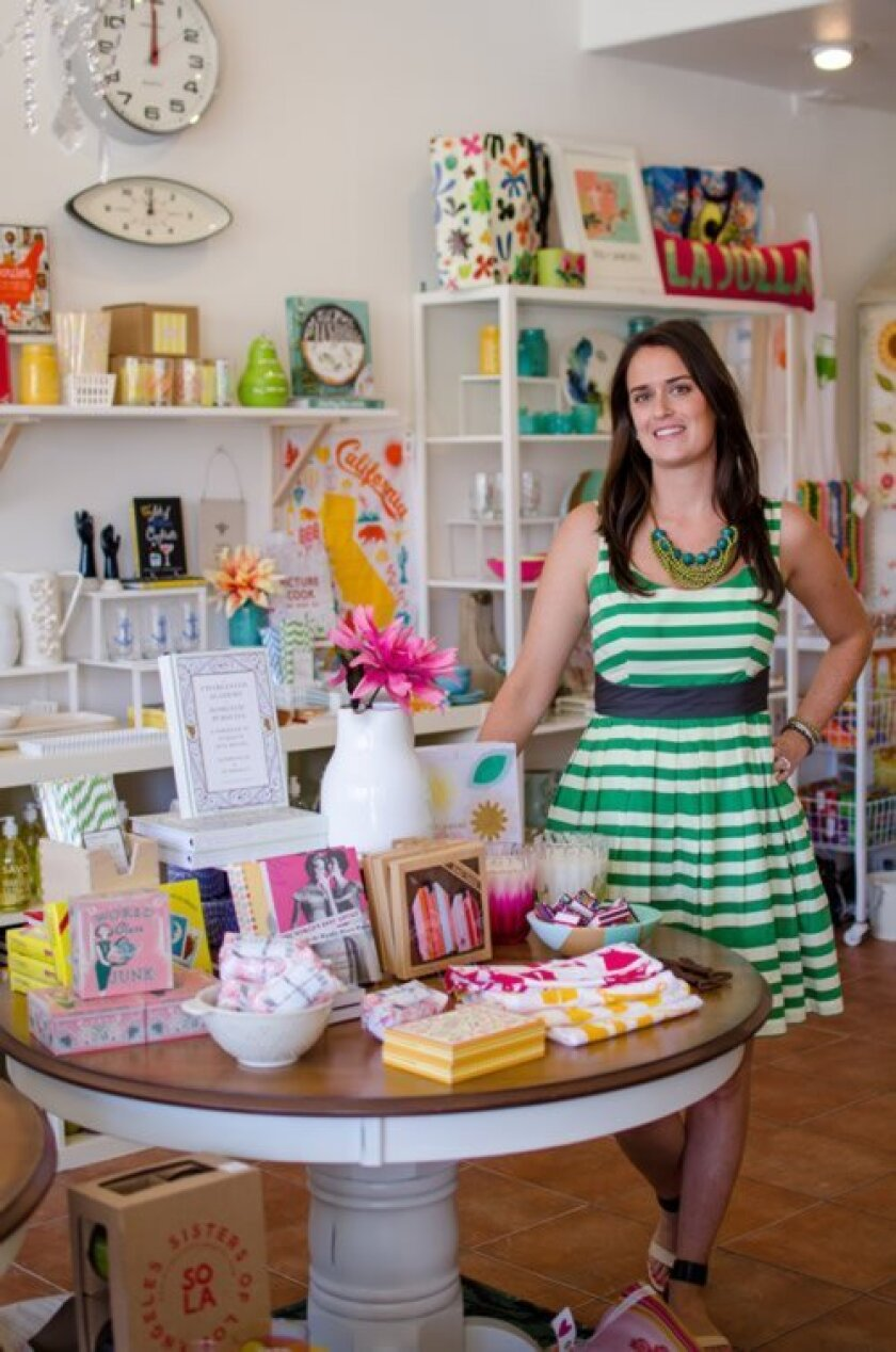 Hi Sweetheart owner Molly Cygan Rossettie displays some of the shop's selections. The store will hold an official grand opening Saturday, May 10 and purchases will be 10 percent off that day.
