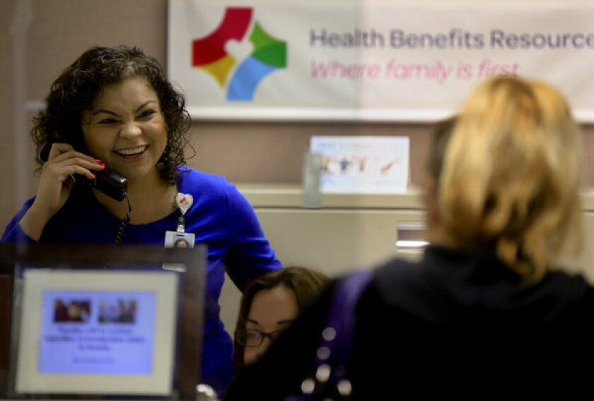 Rosana Herrera, left, operations coordinator at the Health Benefits Resource Center at St. Francis Medical Center in Lynwood, offers daily help and counsel on the Affordable Care Act and insurance exchange issues to confused patients and clients.