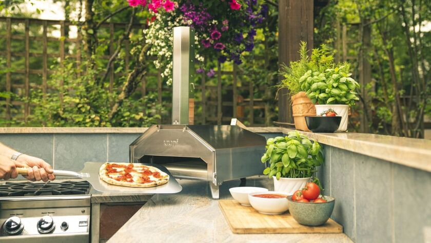 The compact and affordable Ooni (formerly Uuni) pizza oven bakes a 13-inch pie in 60 seconds.