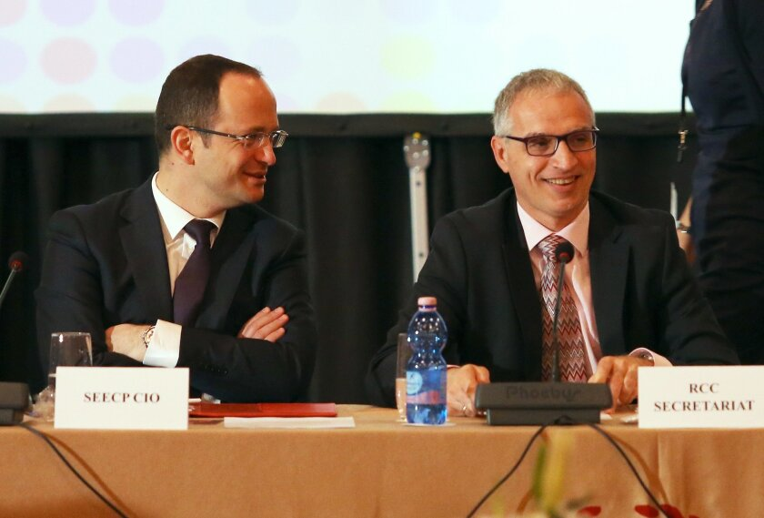 Foreign Minister Ditmir Bushati, left, and Goran Svilanovic, Secretary General of the Regional Cooperation Council of the Southeast European Cooperation Process, head the meeting of Southeast European countries in Tirana, Friday May 22, 2015. Western Balkan countries are urged from the European Union to strengthen their regional cooperation along their steps to join the bloc. (AP Photo/Hektor Pustina)