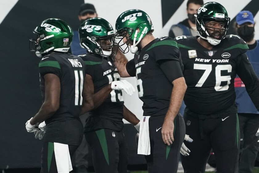New York Jets' Breshad Perriman, second from left, celebrates his touchdown with quarterback Joe Flacco, second from right, during the second half of an NFL football game against the New England Patriots, Monday, Nov. 9, 2020, in East Rutherford, N.J. (AP Photo/Corey Sipkin)