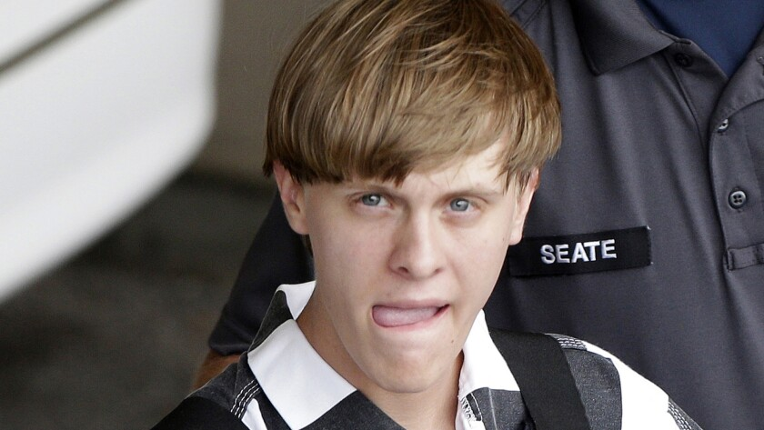 Charleston, S.C., shooting suspect Dylann Roof, shown being escorted from the Cleveland County Courthouse in Shelby, N.C., last week, may have commented on the Daily Stormer, a neo-Nazi website started by Andrew Anglin, 30.