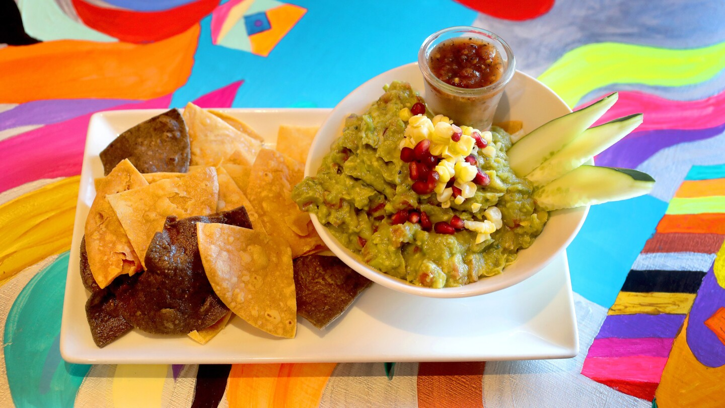 The Lokos Guak is made with hand mashed natural hass avocado and blue corn, red onion with mild jalape–o. Lokos Takos Taqueria in Fort Lauderdale offers a variety of quesadillas served on brightly painted tables. The small, new Mexican restaurant that is big on flavors and colors, with bright artwork decorating the walls. The eatery opened in July on East Commercial Boulevard near the Coral Ridge neighborhood and provides a more satisfying experience than bigger, more touristy Mexican places around Fort Lauderdale. The restaurant excels at authentic flavors, such as very good guacamole and queso fundido to start and carnitas (marinated pork) and barbacoa (marinated beef) tacos on soft corn tortillas. It also offers octopus and lobster tacos. Mike Stocker / South Florida Sun-Sentinel