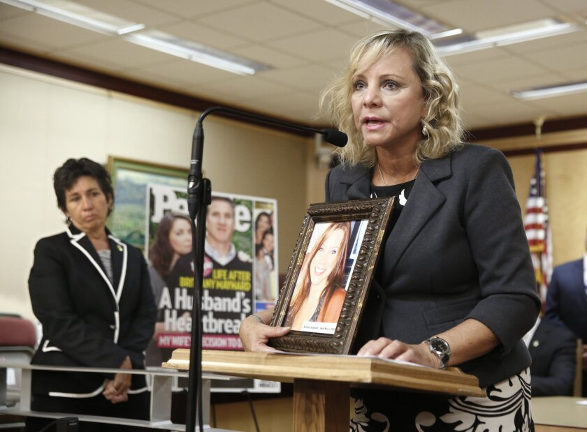 Debbie Ziegler holds a photo of her daughter, Brittany Maynard—a California woman with brain cancer who moved to Oregon to legally end her life last fall—during an Aug. 18 news conference to announce the reintroduction of right to die legislation.