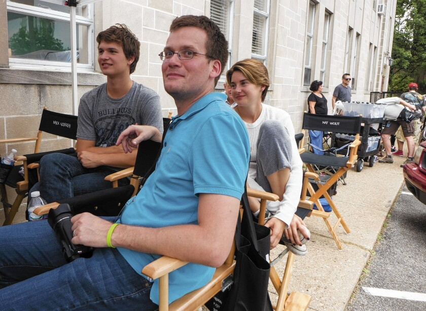 "Author John Green with Ansel Elgort and Shailene Woodley on the set of the movie ""The Fault in Our Stars."""