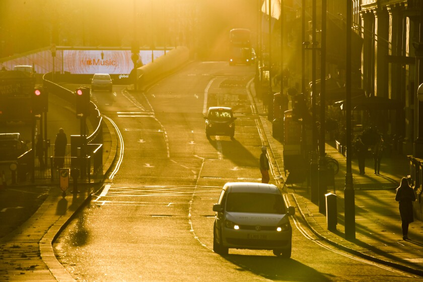 Moderate traffic as the sun sets in London