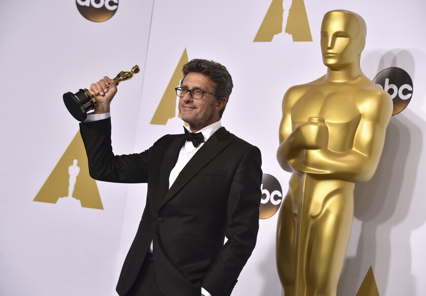 "FILE - In this Sunday, Feb. 22, 2015 file photo, Pawel Pawlikowski poses in the press room with the award for best foreign language film for ""Ida"" at the Oscars on at the Dolby Theatre in Los Angeles. Academy Award-winning Pawel Pawlikowski and other top Polish filmmakers are demanding artistic independence for the nation's most prestigious film festival after a politically charged movie was withdrawn late Wednesday Sept. 18, 2019. (Photo by Jordan Strauss/Invision/AP, file)"