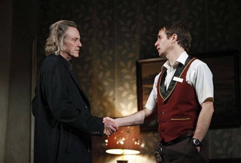 """In this theater publicity image released by Boneau/Bryan-Brown, Christopher Walken, left, and Sam Rockwell are shown in a scene from Martin McDonagh's """"A Behanding in Spokane,"""" now playing at Broadway's Gerald Schoenfeld Theatre in New York. (AP Photo/Boneau/Bryan-Brown, Joan Marcus)"""