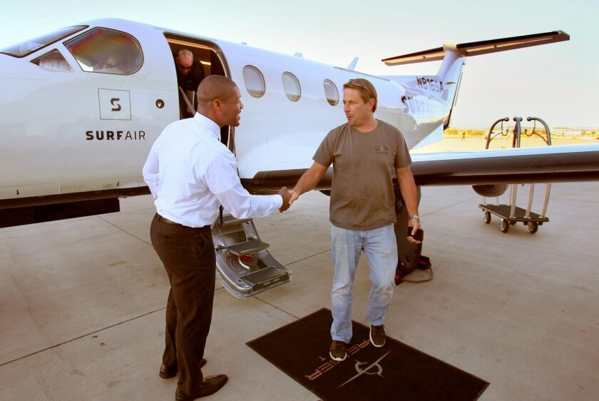 Passenger Bill Parris, at right, shakes hands with Jet Air Lead Concierge Telvin McMillian after getting off a Surf Air flight from Santa Barbara in the late afternoon.