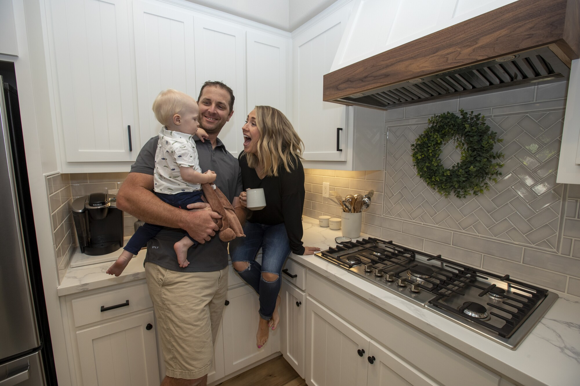 Brian and Rebecca Luke their with son Bennett, 1, in the kitchen of their new home in El Dorado Hills, Calif.
