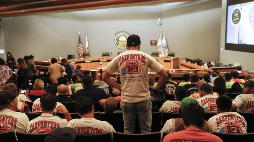 Union shirts were out in large numbers during the Anaheim City Council meeting, where the Council heard public comments on a minimum wage ballot measure aimed at raising Disney workers' wages, in Anaheim, Calif. on June 19.