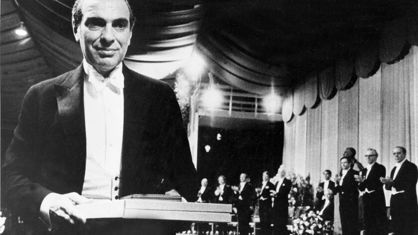 Kenneth Arrow carries his Nobel Prize following ceremonies in Stockholm in 1972.