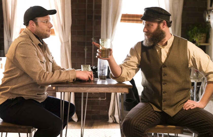 """This image released by HBO Max shows Seth Rogen portraying Ben Greenbaum, left, and Herschel Greenbaum in a scene from """"An American Pickle."""" (Hopper Stone/HBO Max via AP)"""